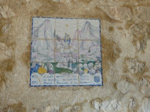 Tile in the church in Provençal language